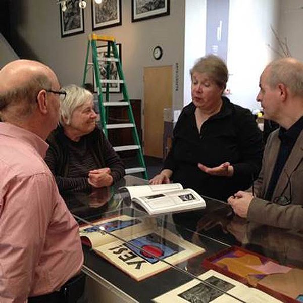 Click the image for a view of: Jack with Claire Van Vliet and Kathleen Burch, co-founder of Center for the Book, SF, showing the exhibition catalogue with Paul van Capelleveen, director of The National Library of the Netherlands