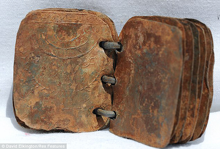 Click the image for a view of: One of the metal tablets, Photo: David Elkington/Rex Features